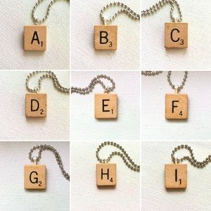 "Frost & Fire Jewelry - 1953 ""U"" Scrabble® Tile Initial Pendant Necklace"
